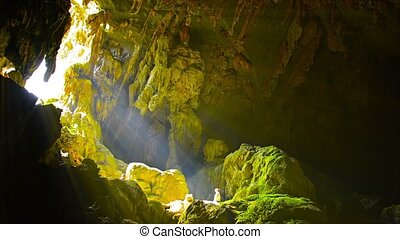 Sun Rays at Mouth of Cave in Vang Vieng, Laos - Video -...