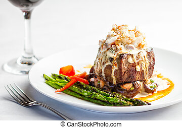 Steak Oscar - A plated meal of steak and crab meat
