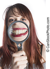 Young Woman Magnifying Smile with Magnifying Glass