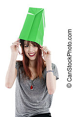 Young Woman with Green Shopping Bag on Head
