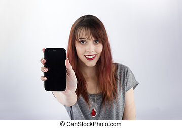 Smiling Woman Showing the Screen of her Phone