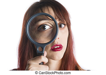 Young Woman Looking Through Magnifying Glass - Close Up of...