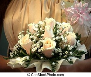 bridal bouquet - hands of bride holding wedding bouquet