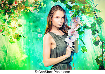 fairy spring - Beautiful young woman among tropical plants...