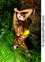 thicket - Beautiful sexual young woman in bikini in the...