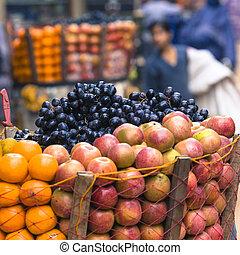 The hawker sell his fruits in Thamel in Katmandu, Nepal.