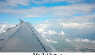 Beautiful Fluffy Clouds with Airliner Wing - Video 1080p...