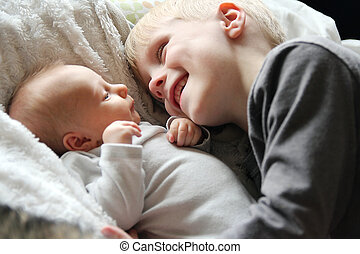 Big Brother Looking at Newborn Baby with Love - A 5 year old...