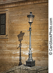 Single metal retro lamp post in Rome, Italy