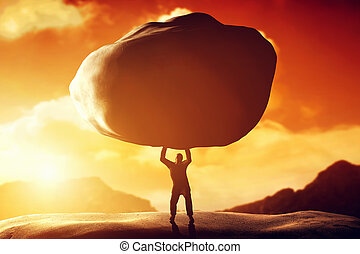 Man lifting a huge rock Metaphor, concept of strength,...