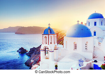 Oia town on Santorini Greece at sunset. Aegean sea - Oia...