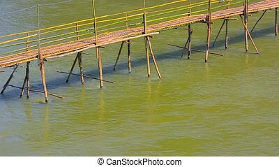 Bamboo Bridge over River near Luang Prabang, Laos - Video...