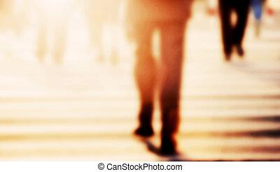 Businessman walking on the street. Blur, vintage mood....