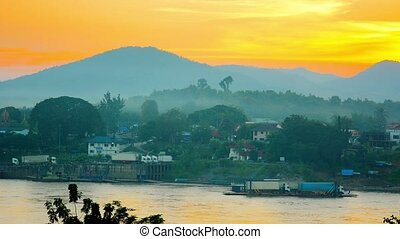 Cargo Trucks on River Barge at Sunset in Laos - FullHD...