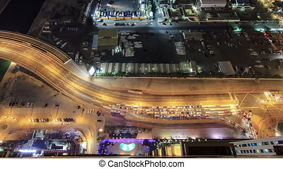 City view of Dubai road with traffic from skyscraper at night timelapse
