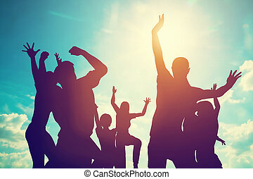 Happy friends, family jumping together having fun. Freedom,...