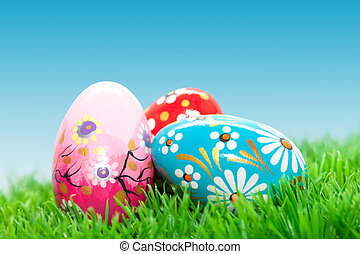 Handmade Easter eggs on grass. Spring patterns, unique. -...