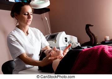 Beauty treatment in modern beauty salon. Beautician...