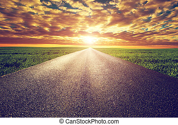 Long straight road, way towards sunset sun - Long straight...