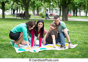 Students play a game in the park twister, beautiful, indoor,...
