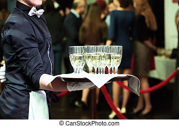 Waiter with tray and wine glasses at party - catering or...