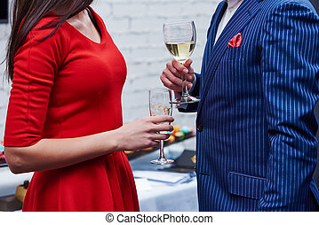 man and woman with glasses of wine at party - Party. Two...