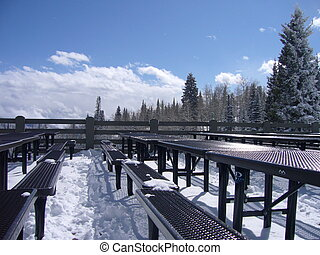 Snow Tables - Tables covered in snow with a scenic...