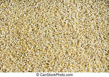 Background texture of cracked or crushed wheat