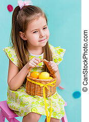 Little girl with basket of eggs - Thoughtful little girl...
