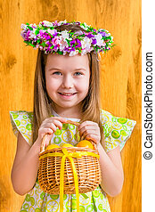 Little girl with basket of eggs - Portrait of adorable...