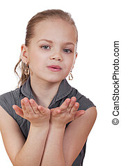 Blonde little Girl Blowing a Kiss, isolated on white background