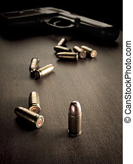bullets and handgun - bullets with handgun in the back of...