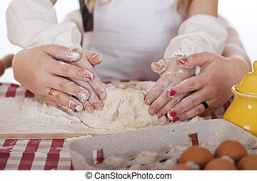 Close up hands of family are baking cakes in home kitchen -...