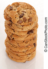 chunkie chocolate chip cookie stack with reflection on white background