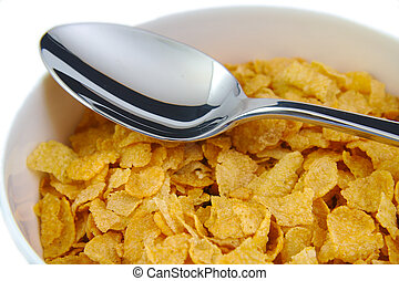 Bunch of corn flake cereals with a metal spoon Breakfast...