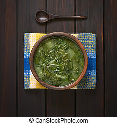 Chard Soup - Overhead shot of a rustic bowl of chard soup on...