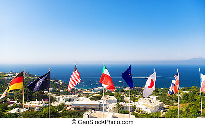 National flags on sea coast background