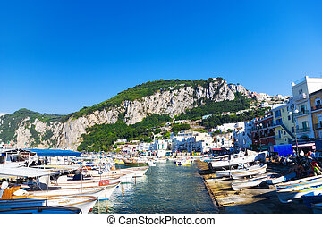 Capri island in Italy. View on a harbour with ships.