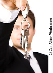 Young businessman holding keys