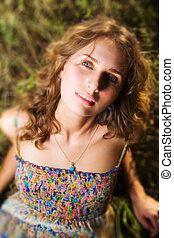Young woman on a summer field Shallow dof effect