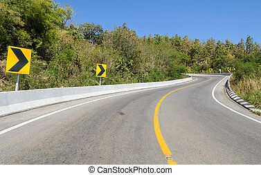Forest road with warning sign - Forest road with barrier and...