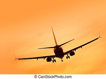 Aircraft Landing at Sunset - Commercial Passanger Airplane...