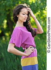 beautiful elegant brunette girl in a field