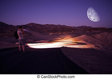Hiking at Night with Flashlight - Hiker with Powerful...