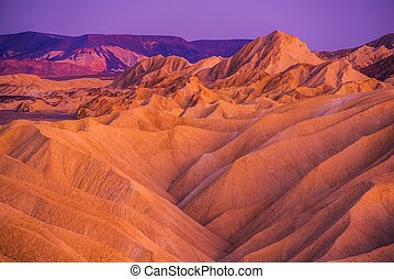 Death Valley Badlands Formation at Dusk. Death Valley...