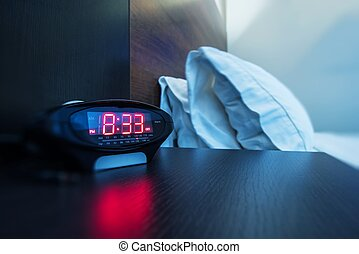 Hotel Room Alarm Clock. Waking Up in a Hotel Photo Concept....