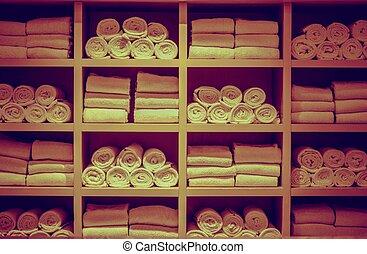 Resort Swimming Pool Towels Wooden Square Rack Closeup.