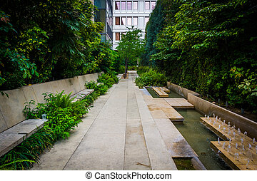 Foliage and small fountains along a walkway in downtown...