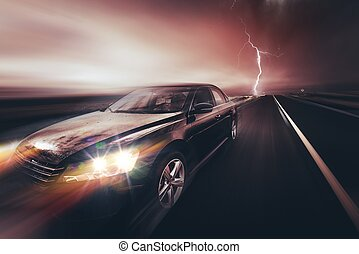 Speeding Compact Car and the Storm. Car on the Highway.