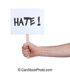 Hand holding sign, isolated on white - Hate